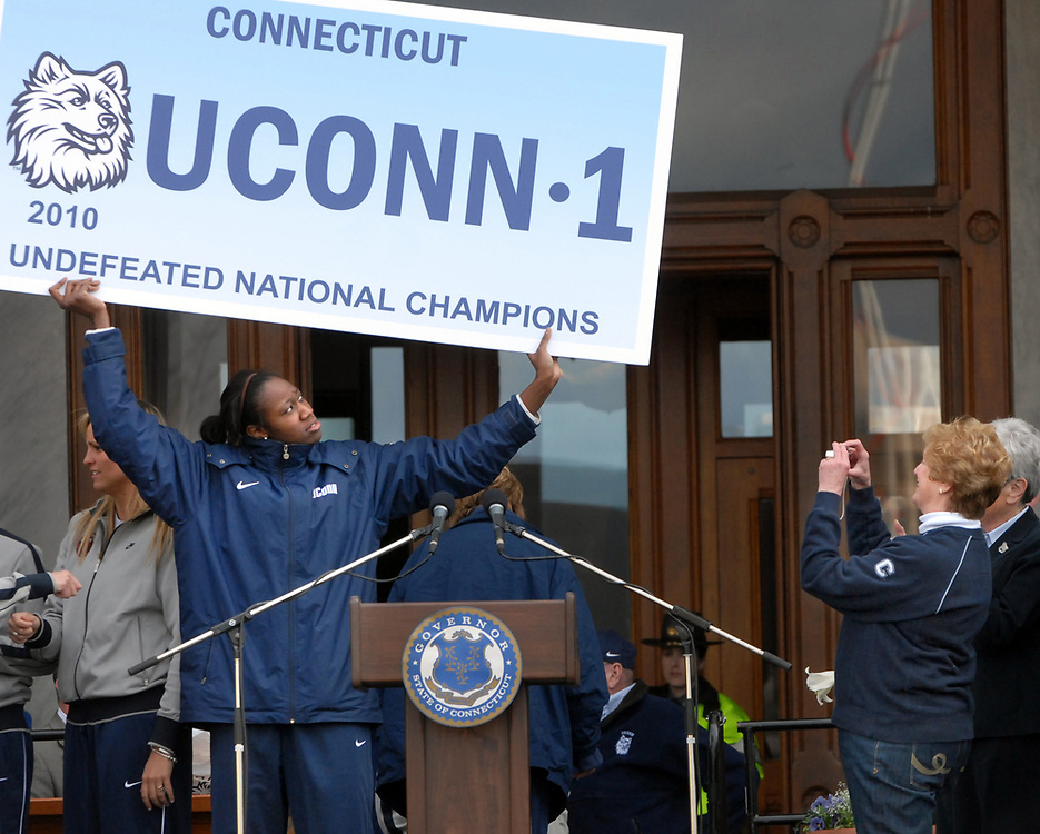 4/18/10 2UConn Parade<br /> ML0602H<br /> UConn women's basketball team victory parade and rally, Hartford: Tina Charles left poses for a photo by Gov. M. Jodi Rell right, on the steps to the State Capitol after a rally for the team. Photo by Mara Lavitt