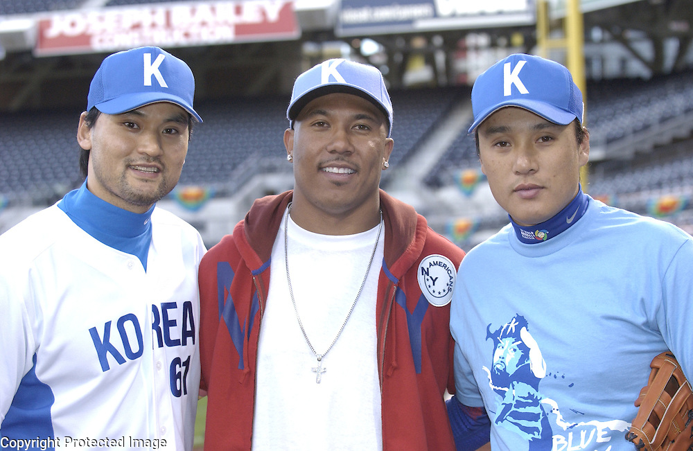 Team Korea's Chan Ho Park (L), Pittsburgh Steelers Hines Ward (C) and Seung Yeop Lee (R) pose during warm ups before the start of the game against Team Japan in Semi-Final action of the World Baseball Classic at PETCO Park, San Diego, CA.