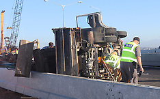 Auckland-Truck and digger roll, Northwestern Motorway