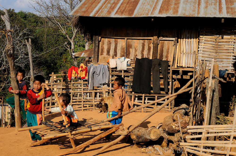Burma/Myanmar. Akha children in front of the house.