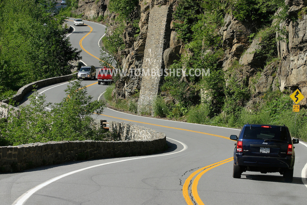 Deerpark, N.Y. - Cars travel along the Hawk's Nest area of Route 97 in the Town of Deerpark, N.Y., on July 6, 2006. ©Tom Bushey