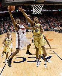 Virginia Cavaliers point guard Sean Singletary (44) shoot over Georgia Tech Yellow Jackets Forward Jeremis Smith (32).  The Virginia Cavaliers Men's Basketball Team defeated the Georgia Tech Yellow Jackets 75-69 at the John Paul Jones Arena in Charlottesville, VA on February 24, 2007.