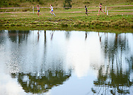 GEORGE, SOUTH AFRICA - SEPTEMBER 10: athletes runs past the small dam in the junior women 8km during the  2016 South African Cross Country Championships held at The Olympia School of Skills in Pacaltsdorp on September 10, 2016 in George, South Africa. (Photo by Roger Sedres/Gallo Images)