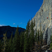 Steve Campbell leading a 5.11a Rock Climb at Barrier Mountain in Kananaskis, Canadian Rockies, Canada