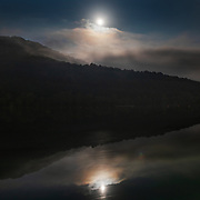 The moon rises over the Kanawha River at Glen Ferris, W,Va., on Monday, August 28, 2018.