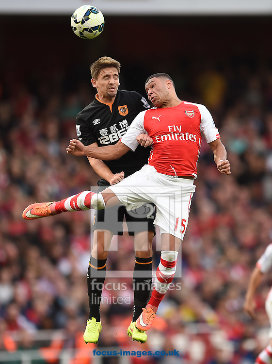 Alex Oxlade Chamberlain of Arsenal and Gaston Ramirez of Hull City during the Barclays Premier League match at the Emirates Stadium, London<br /> Picture by Andrew Timms/Focus Images Ltd +44 7917 236526<br /> 18/10/2014