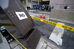 Police tape marks a damage utility box, found on a Center City Philadelphia, PA street, on February 2nd 2017. A Vote of NO Confidence sign is posted on a damage box.