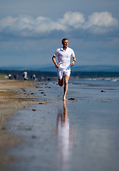 Pictured: Scottish Liberal Democrat leader Willie Rennie MSP runs along the beach at St Andrews.<br /> <br /> <br /> <br /> Ger Harley | EEm date