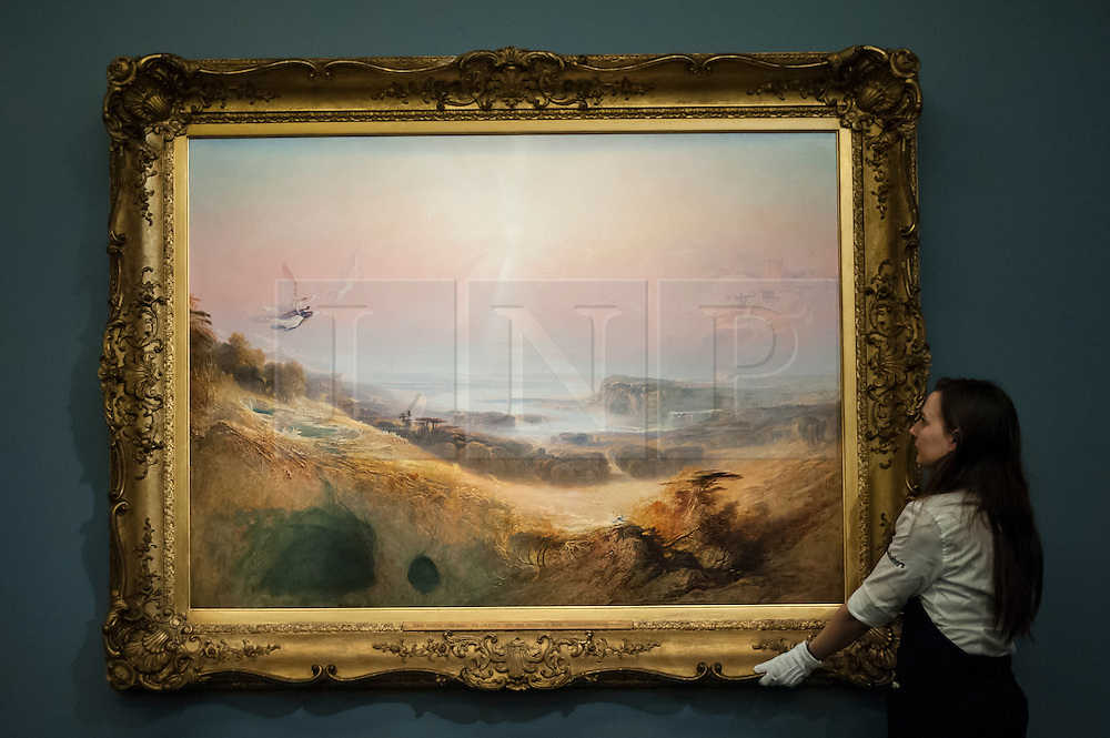 "© Licensed to London News Pictures. 06/07/2015. London, UK.  A Sotheby's technician shows John Martin's ""The Celestial City and the River of Bliss"" (est. £2m to £3m) at the preview of Old Masters, British Paintings and Masterworks from the collection of Castle Howard at Sotheby's ahead of the auction on July 8. Photo credit : Stephen Chung/LNP"