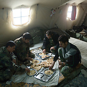Afghan National Army soldiers take a break from the fighting in their tents and eat meat from a sacrificed sheep and combine it with rice and bread for soldiers to celebrate the second EID also known as the Festival of Sacrifice at a Forward Operating Base on the front lines in Zhari District located west of Kandahar City, Afghanistan. There are two celebrations of EID during the second it is common to sacrifice an animal, which is to commemorate and celebrate the sacrifice of the Prophet Abraham also known as Ibrahim.