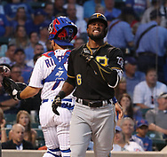 August 30, 2017 - Chicago, IL, USA - The Pittsburgh Pirates' Starling Marte (6) reacts after getting hit by a pitch against the Chicago Cubs during the first inning at Wrigley Field in Chicago on Wednesday, Aug. 30, 2017. (Credit Image: © Nuccio Dinuzzo/TNS via ZUMA Wire)