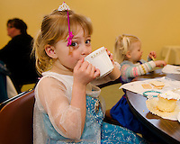Addy Beane enjoys a cup of tea with Ayla Balint during Elsa and Anna's Tea Party at the Gilford Community Center on Saturday morning.  (Karen Bobotas/for the Laconia Daily Sun)