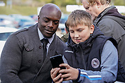 Adebayo Akinfenwa of Wycombe Wanderers poses for a selfie with a Wycombe Wanderers fan during the EFL Sky Bet League 1 match between Wycombe Wanderers and Sunderland at Adams Park, High Wycombe, England on 19 October 2019.