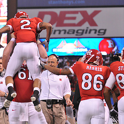Dec 19, 2009; St. Petersburg, Fla., USA; Rutgers center Ryan Blaszczyk (61) lifts wide receiver Tim Brown (2) into the air in celebration of Brown's touchdown during NCAA Football action in Rutgers' 45-24 victory over Central Florida in the St. Petersburg Bowl at Tropicana Field.