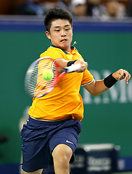 SHANGHAI, Oct. 10, 2018  China's Wu Yibing hits a return during the men's singles second round match against Japan's Kei Nishikori at the Shanghai Masters tennis tournament on Oct. 10, 2018. Wu Yibing lost 1-2. (Credit Image: © Fan Jun/Xinhua via ZUMA Wire)