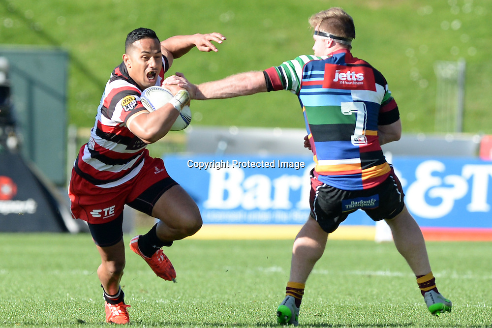 Counties Manukau's Toni Pulu tries to avoid a tackle by North Harbour's James Doyle during the ITM Cup match between North Harbour and Counties Manukau. QBE Stadium, Auckland, New Zealand. Saturday 12 September 2015. Copyright Photo: Raghavan Venugopal / www.photosport.nz
