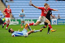 Coventry City's James O'Brien tackles Bristol City's Luke Freeman  - Photo mandatory by-line: Joe Meredith/JMP - Mobile: 07966 386802 - 18/10/2014 - SPORT - Football - Coventry - Ricoh Arena - Bristol City v Coventry City - Sky Bet League One