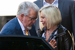 London, June 19th 2014. Entertainer and artist Rolf Harris and his daughter Bindi arrive at Southwark Crown Court as the jury in his tial on twelve charges of indecent assault against four girls aged 7 to 19 is expected to begin its deliberations.