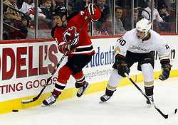 February 8, 2008; Newark, NJ, USA;  New Jersey Devils right wing David Clarkson (23) skates by Anaheim Ducks defenseman Kent Huskins (40) during the second period at the Prudential Center in Newark, NJ.