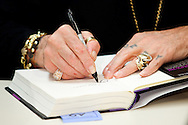 Singer Ozzy Osbourne signs copies of his memoir, I Am Ozzy, at Warwick's bookstore in La Jolla, Feb. 19, 2010.