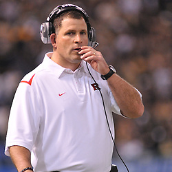 Dec 19, 2009; St. Petersburg, Fla., USA; Rutgers head coach Greg Schiano talks to coaches in the booth during NCAA Football action in Rutgers' 45-24 victory over Central Florida in the St. Petersburg Bowl at Tropicana Field.