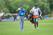Jordan Spieth and his caddy, Michael Greller, walk down the fairway during the first round of the AT&T Byron Nelson in Las Colinas, Texas on May 28, 2015. (Cooper Neill for The New York Times)