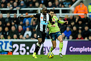 Jetro Willems (#15) of Newcastle United and Adam Smith (#15) of AFC Bournemouth battle for possession of the ball during the Premier League match between Newcastle United and Bournemouth at St. James's Park, Newcastle, England on 9 November 2019.