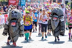 © Licensed to London News Pictures. 22/04/2018. London, UK. Two runners dressed as rhinos pass the Cutty Sark in Greenwich during the Virgin Money London Marathon 2018. Photo credit: Rob Pinney/LNP