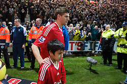 PRESTON, ENGLAND - Saturday, January 3, 2009: Liverpool's captain Steven Gerrard MBE leads his team out against Preston North End during the FA Cup 3rd Round match at Deepdale. (Photo by David Rawcliffe/Propaganda)