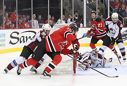 Mar 15; Newark, NJ, USA; New Jersey Devils center Jacob Josefson (16) takes a shot on Colorado Avalanche goalie Jean-Sebastien Giguere (35) during the second period at the Prudential Center.