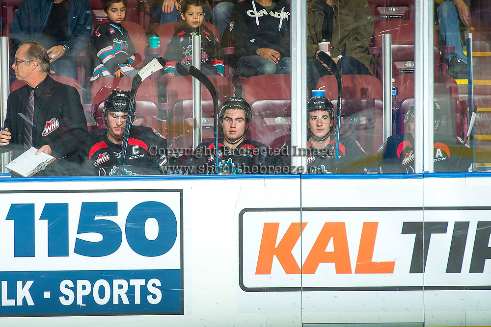 KELOWNA, CANADA - OCTOBER 4: Cal Foote #25, Dillon Dube #19, James Hilsendager #2 and Gordie Ballhorn #4 of the Kelowna Rockets sit in the penalty box against the Victoria Royals on October 4, 2017 at Prospera Place in Kelowna, British Columbia, Canada.  (Photo by Marissa Baecker/Shoot the Breeze)  *** Local Caption ***