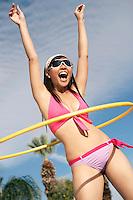 Young woman in bikini with hoop