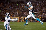 Carolina Panthers running back Christian McCaffrey (22) leaps and celebrates with Carolina Panthers running back C.J. Anderson (20) after catching a 25 yard touchdown pass that cuts the Pittsburgh Steelers second quarter lead to 24-14 during the NFL week 10 regular season football game against the Pittsburgh Steelers on Thursday, Nov. 8, 2018 in Pittsburgh. The Steelers won the game 52-21. (©Paul Anthony Spinelli)