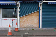 A boarded-up cafe with wonky shutters on the Western Esplanade at Southend.