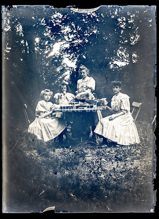 young girls having lunch in the garden France ca 1920s