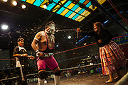 Caption: Maria Eugenia Herrera Mamani alias Claudina La Maldita throws foam on the face of her opponent during a wrestling match in El Alto, Bolivia, February 26, 2012.
