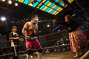 Caption: Maria Eugenia Herrera Mamani alias Claudina La Maldita throws foam on the face of her opponent during a wrestling match in El Alto, Bolivia, February 26, 2012.