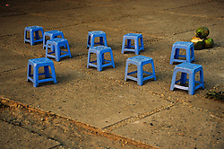 Empty blue plastic stools of a street coffee shop in Truc Bach lake, Hanoi, Vietnam, Asia