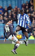 Lucas Joao of Sheffield Wednesday is tackled by George Thorne of Derby County during the Sky Bet Championship match at Hillsborough, Sheffield<br /> Picture by Graham Crowther/Focus Images Ltd +44 7763 140036<br /> 06/12/2015