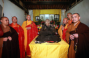 QUANZHOU, CHINA - JANUARY 10: (CHINA OUT) <br /> <br /> Monks stand by monk Fuhou\'s body which was found not rotted after putting in a vat for three and a half years at Puzhao temple on Zimao Mountain on January 10, 2016 in Quanzhou, Fujian Province of China. 94-year-old monk Fuhou died in 2012 and his body was put by the sitting position into a vat with a cover for three and a half years. Monks found that Fuhou\'s body wasn\'t rotted on an opening vat rite on January 10 at Puzhao temple on Zimao Mountain in Quanzhou. The body would be cleaned and stuck with gold to be made into a golden Buddha. <br /> ©Exclusivepix Media