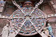 Anicca, God of Destiny holds wheel of life of Buddhist Karma, Dazu rock carvings, Mount Baoding, China