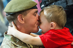 © Licensed to London News Pictures . 25/04/2013. Catterick Barracks , North Yorkshire , UK . Stephen Rumble (Dad , 26) hugs son Stephen Rumble Jnr (2) (all correct) . Soldiers from the 1st Battalion , the Duke of Lancaster's Regiment (1 Lancs) arrive at Catterick Barracks to be greeted by their families this evening (Thursday 25th April), following a six month tour in Lashkar Gah , Helmand Province , Afghanistan . With the UK combat mission due to complete by the end of 2014 , this is likely to be the last deployment by 1 Lancs in Afghanistan , the British Army reports . Photo credit : Joel Goodman/LNP