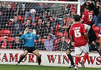 Photo: Paul Thomas.<br /> Walsall v Southend. Coca Cola League 1.<br /> 13/08/2005.<br /> <br /> Matthew Frayett puts a goal past Southend keeper Daryl Flahavan.