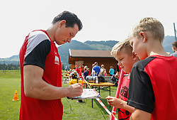 24.07.2015, Sportplatz, Walchsee, AUT, Trainingslager, FC Augsburg, im Bild Pjotr Trochowski (FC Augsburg #36) schreibt Autogramme fuer jugendliche Fans auf dme Trainingsplatz // during the Trainingscamp of German Bundesliga Club FC Augsburg at the Sportplatz in Walchsee, Austria on 2015/07/24. EXPA Pictures © 2015, PhotoCredit: EXPA/ Eibner-Pressefoto/ Krieger<br /> <br /> *****ATTENTION - OUT of GER*****