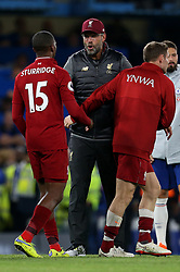 Liverpool manager Jurgen Klopp with Daniel Sturridge at full time
