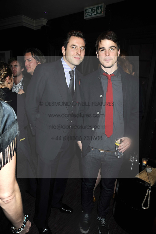 Left to right, DAVID WALLIAMS and JOSH HARTNETT at a party to celebrate the launch of Hollywood Domino - a brand new board game, held at Mosimann's 11b West Halkin Street, London on 7th November 2008.  The evening was in aid of Charlize Theron's Africa Outreach Project.