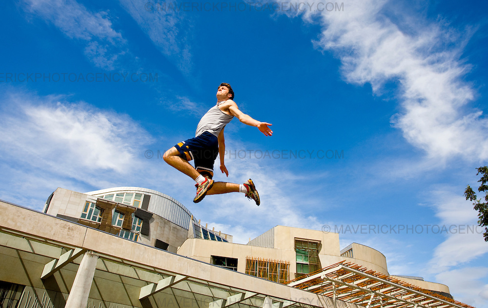 "..John Hall leaps over the Scottish Parliament to launch the new ""Urbathon"" event to be held in Scotlands capital...HUNDREDS of runners will have the chance to jump, climb and crawl their way through the capital in the first  10 kilometre race of its kind to take place in Scotland which involves obstacle course challenges. ..Picture Michael Hughes/Maverick"