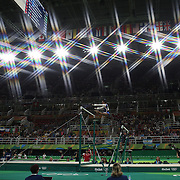 Gymnastics - Olympics: Day 6  Simone Biles #391 of the United States in action during her Uneven Bars routine during her gold Medal performance in the Artistic Gymnastics Women's Individual All-Around Final at the Rio Olympic Arena on August 11, 2016 in Rio de Janeiro, Brazil. (Photo by Tim Clayton/Corbis via Getty Images)<br /> <br /> (Note to editors: A special effects starburst filter used in the creation of this image)
