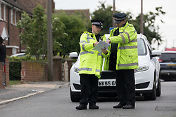 © Licensed to London News Pictures. 01/07/2017. GRAYS, Essex, UK.  Police officers at the cordon at Blackshots Lane in Grays, Essex. A man has died and three others have life threatening injuries following a street fight in Blackshots Lane, Grays, Essex last night.  Photo credit: Vickie Flores/LNP