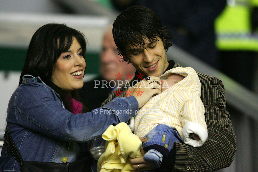 LIVERPOOL, ENGLAND- WEDNESDAY DECEMBER 8th 2004: Liverpool's Luis Garcia with wife and new-born baby in the director's box before the UEFA Champions League Group A match at Anfield. (Pic by David Rawcliffe/Proparganda)